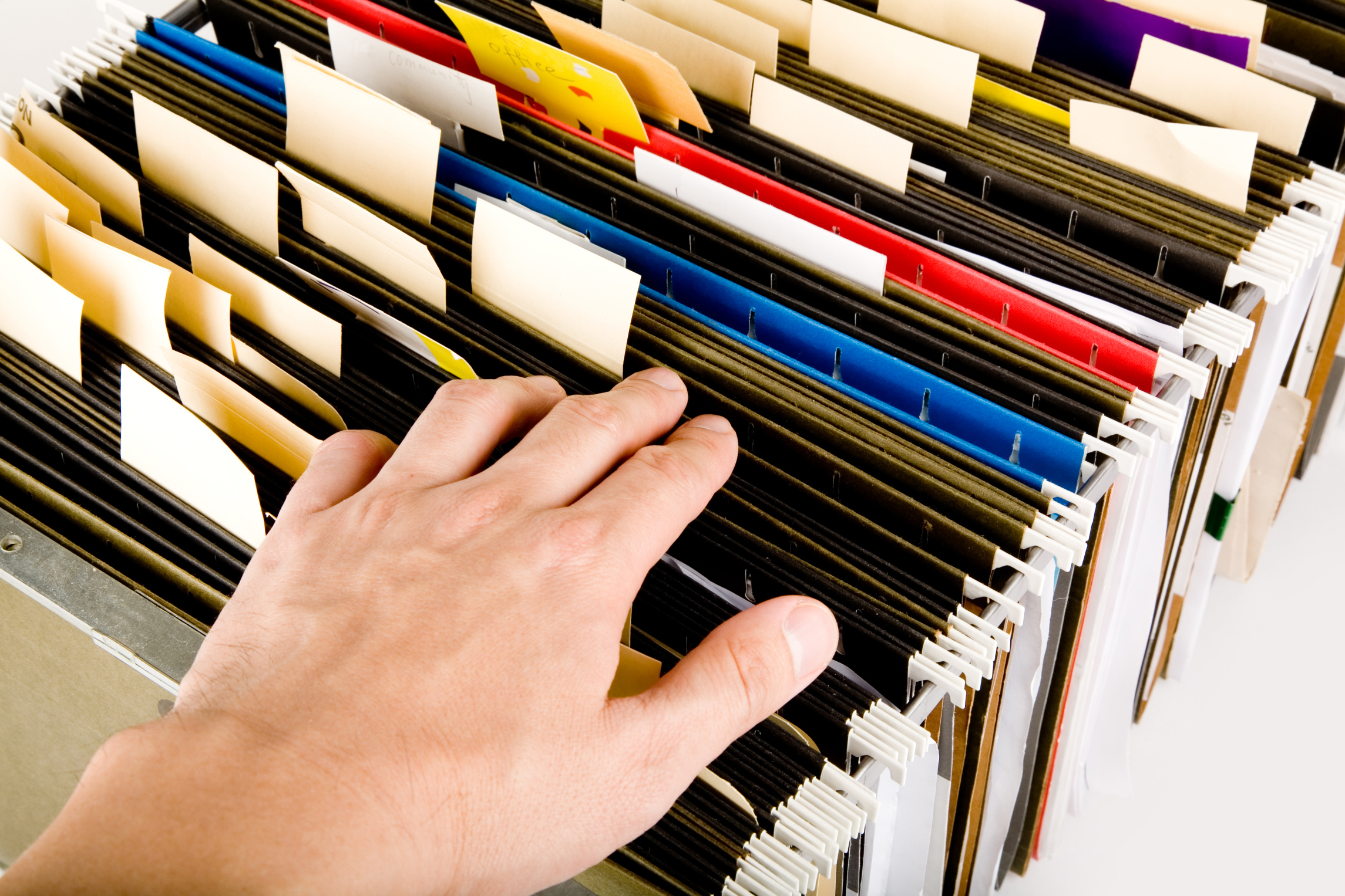 Hand Touching Row of Folders