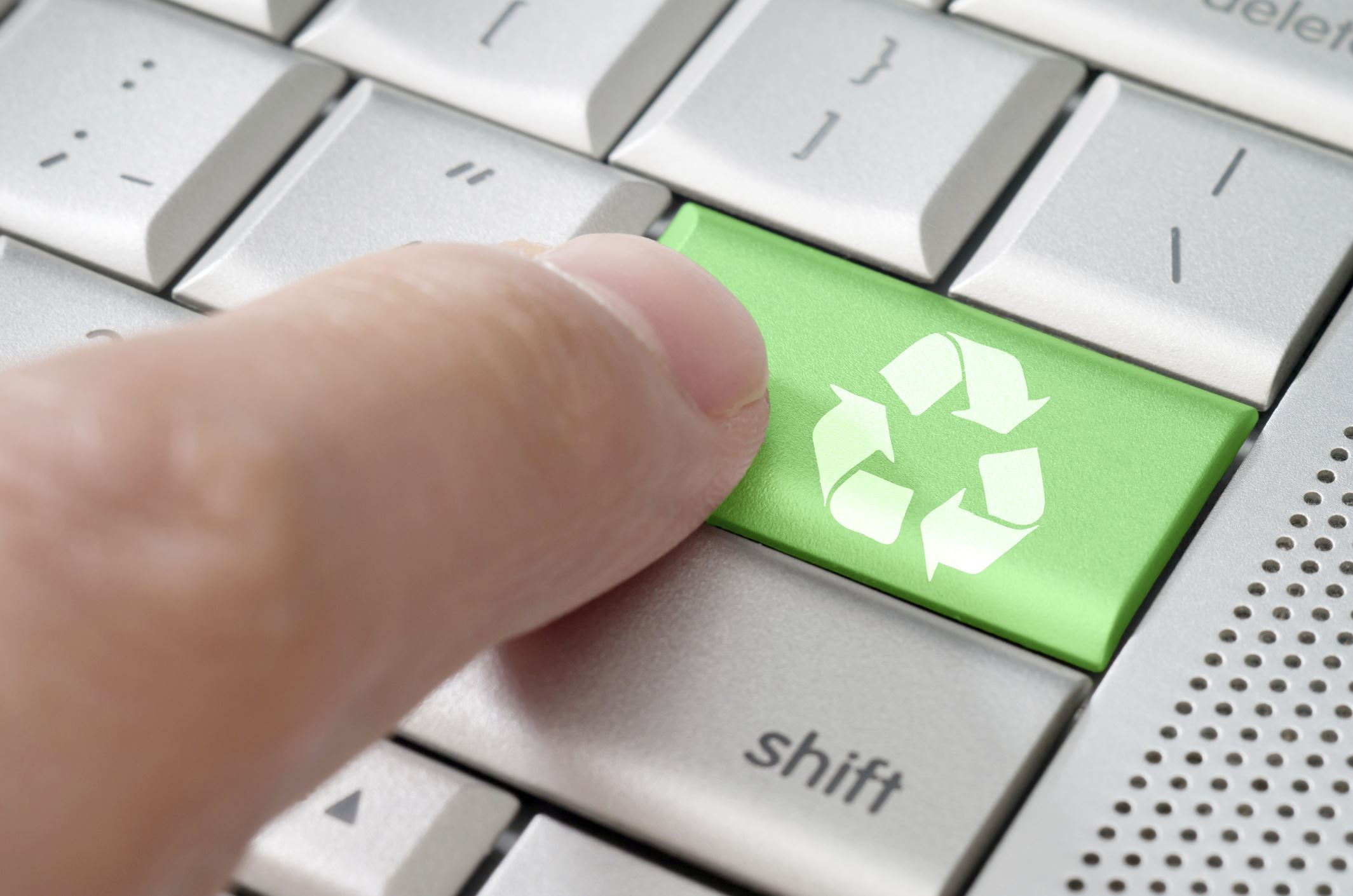 Finger Pressing Green Recycle Button on Keyboard